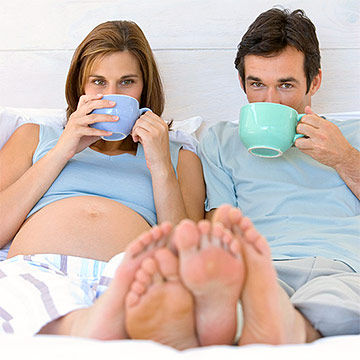 pregnant couple drinking tea