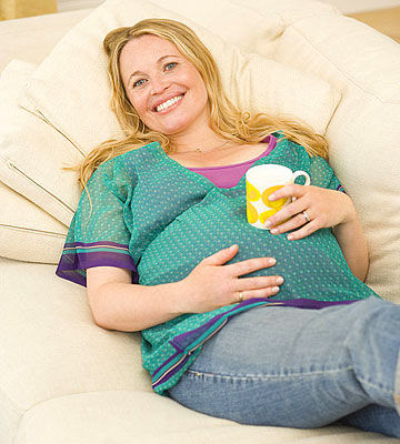 pregnant woman lying on couch