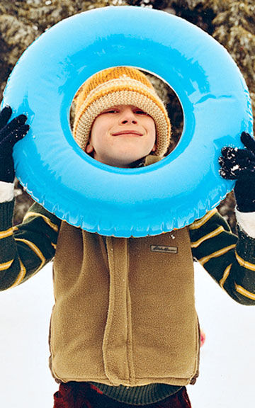 Boy holding an inflatable tube
