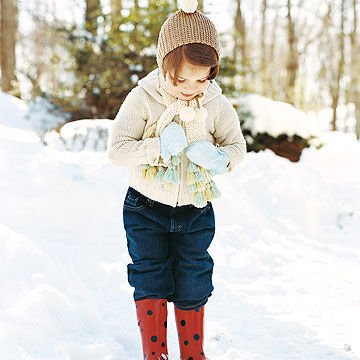 child outside in the snow