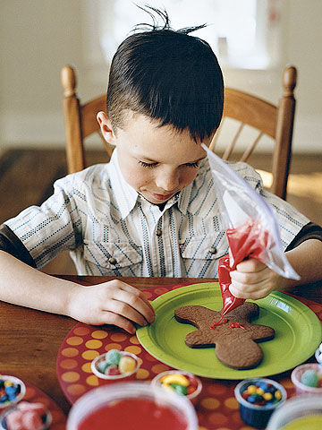 boy frosting gingerbread cookie