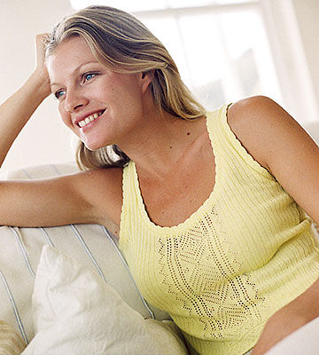woman sitting on couch