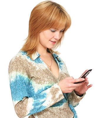 woman text messaging on her cell phone