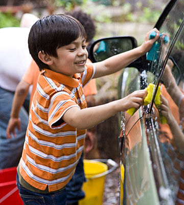 boy washing car