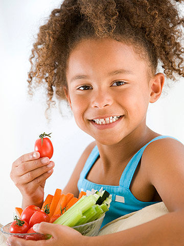 girl eating veggies