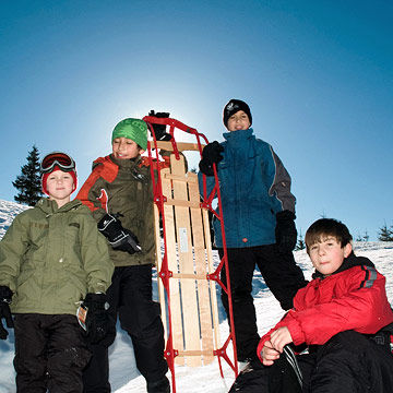 4 boys and sled