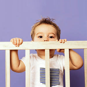 Child looking over bars