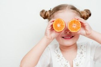 Kid with fruit