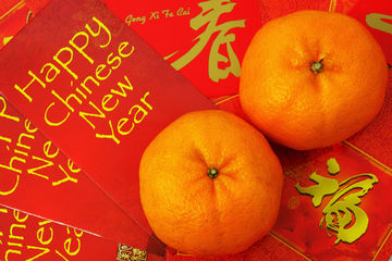 Chinese New Year red envelopes and oranges