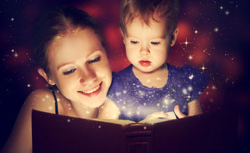 Mom reading book to baby