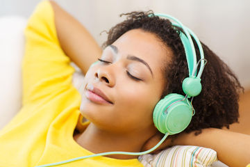 African-American woman listening to music with her eyes closed