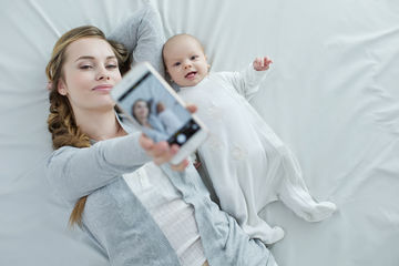 Woman and baby taking a picture with phone