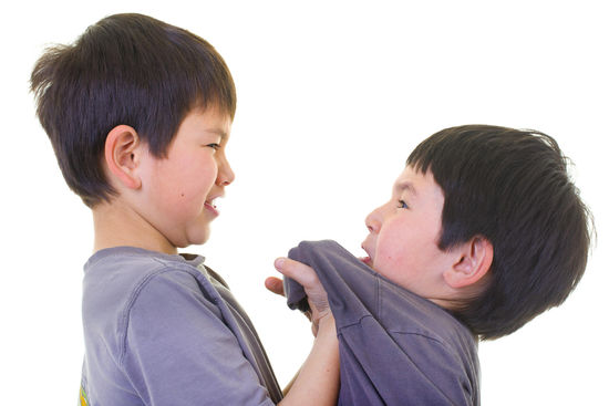 young boy bullying another boy