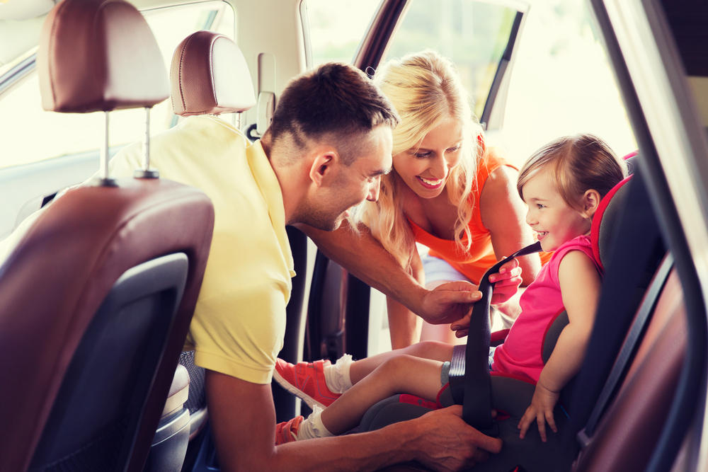 Road Trip Safety Tips Family Straps Daughter In Car Seat