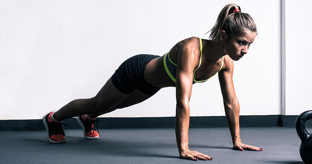 Woman Doing Push Up Body Toning
