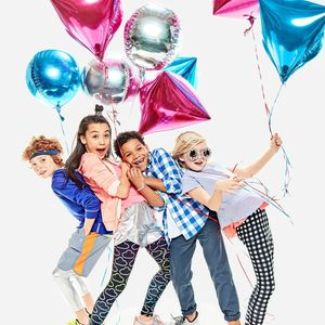 Rockets of Awesome Kids Holding Balloons