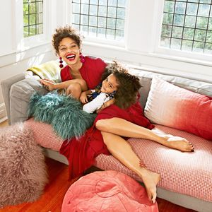 Mother Daughter Laughing On Sofa