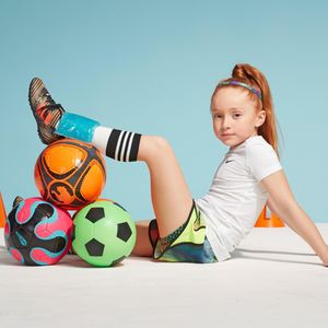 Young Girl Red Hair Twisted Ankle Elevated with Ice Pack