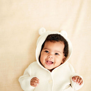 Baby In White Bear Hood Smiling