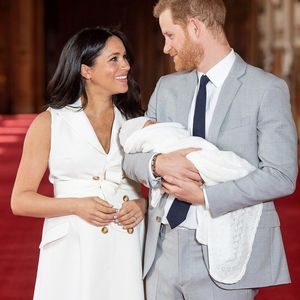 meghan markle and prince harry looking at each other with son archie harrison