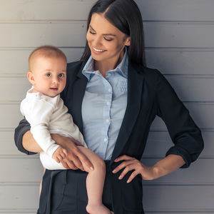 Quizler Home Or Work Career Mom Result Business Women Holding Baby