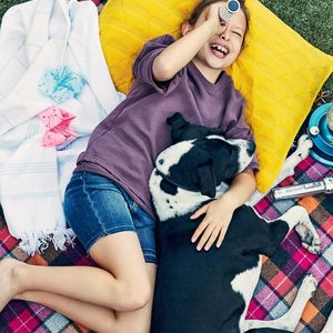 Young Girl Laying Outside with Dog Star Gaze