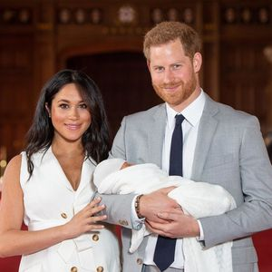 meghan markle and prince harry holding newborn son archie harrison
