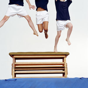 boys jumping gymnastics