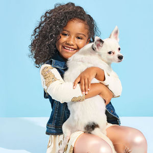 girl holding chihuahua