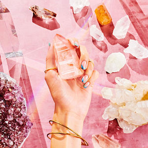 Hand Holding Healing Crystals