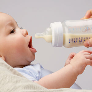 baby being formula fed with bottle