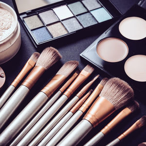 Makeup Brushes and Eyeshadow Palette on Table