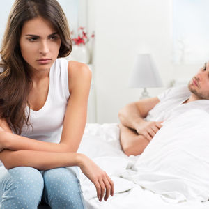Couple Fighting Sitting on Bed