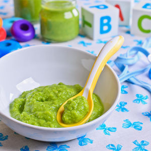 Green Puree Baby Food With Baby Toys