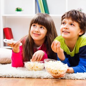 Movies For Siblings Two Kids Watching TV With Popcorn