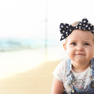 baby girl with polka dot bow