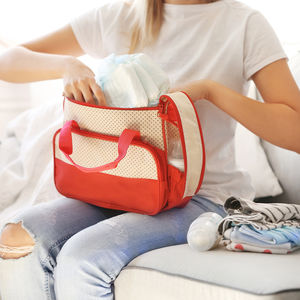 woman with diaper bag