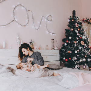 Mom breastfeeding baby during Christmas