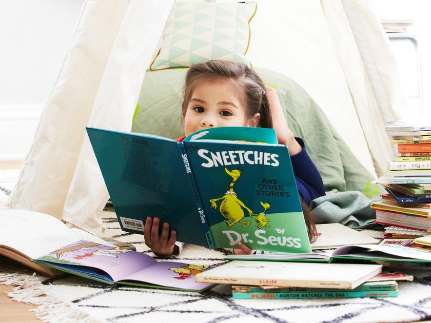 Little Girl Reading Dr. Seuss The Sneetches Book