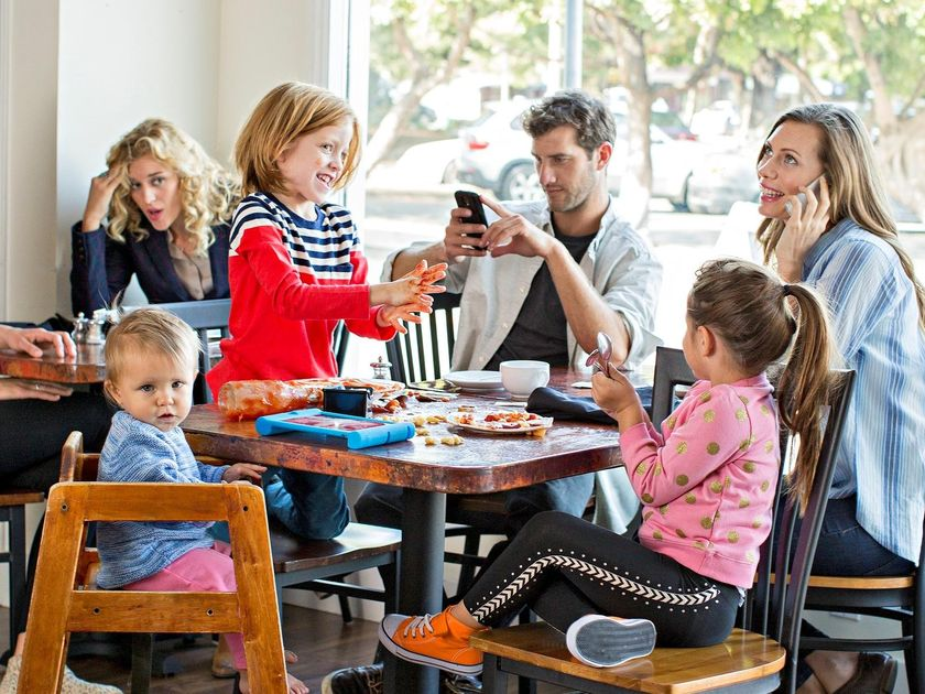 Parents Ignore Children Misbehavior Eating Out