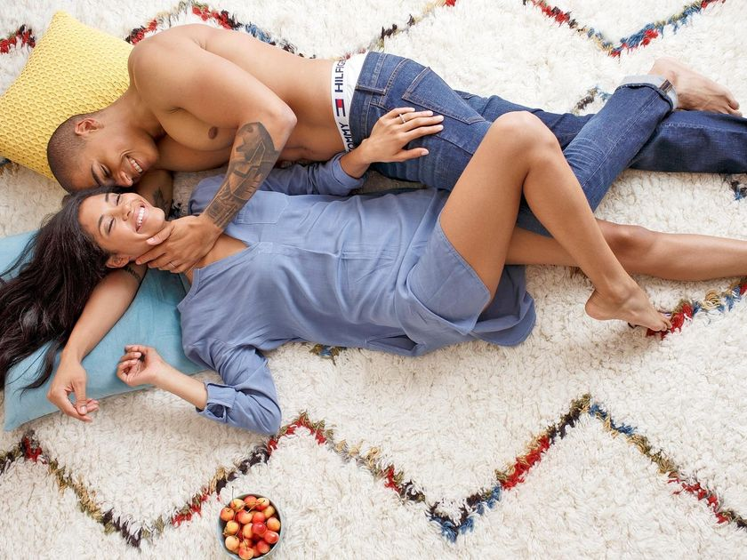 Couple Laying On Carpet With Cherries