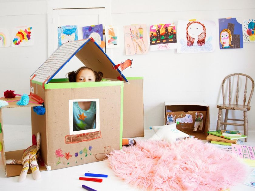 Creative Girl Playing In Cardboard Box House