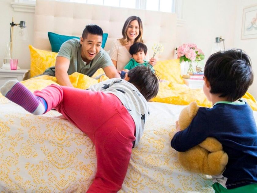 Kids Climbing on Parents Bed