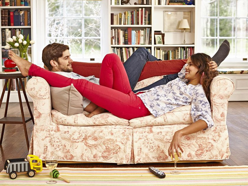Couple Laying on Couch with Glass of White Wine