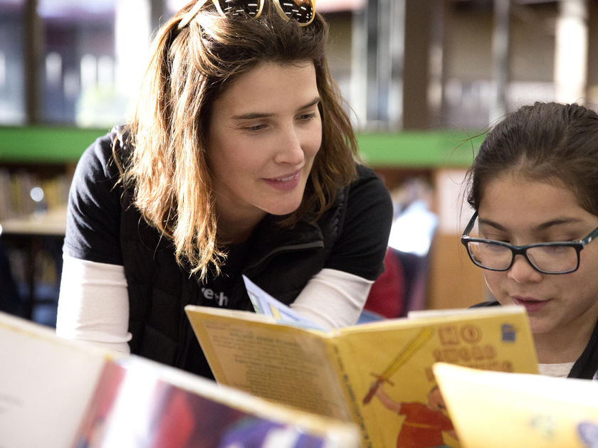 Actress Cobie Smulders Reading with Young Girl