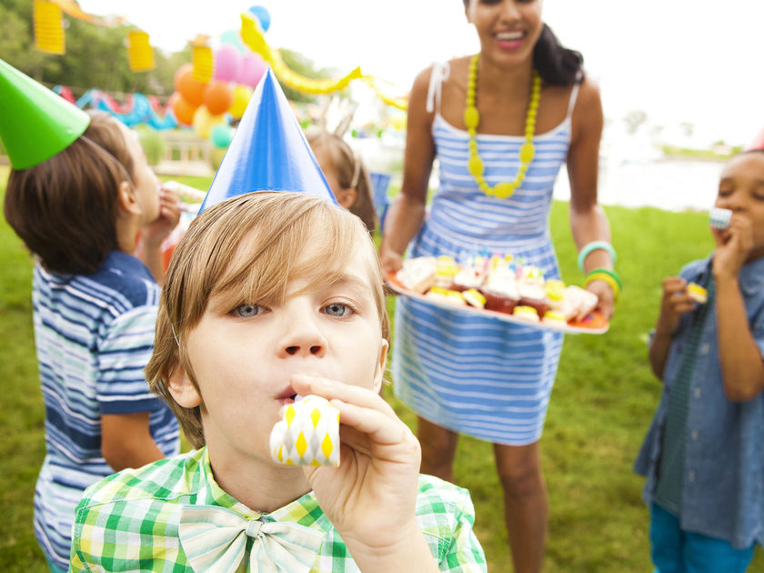 Woman serving cupcakes at birthday party