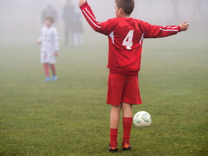 Air Pollution Boy Plays Soccer