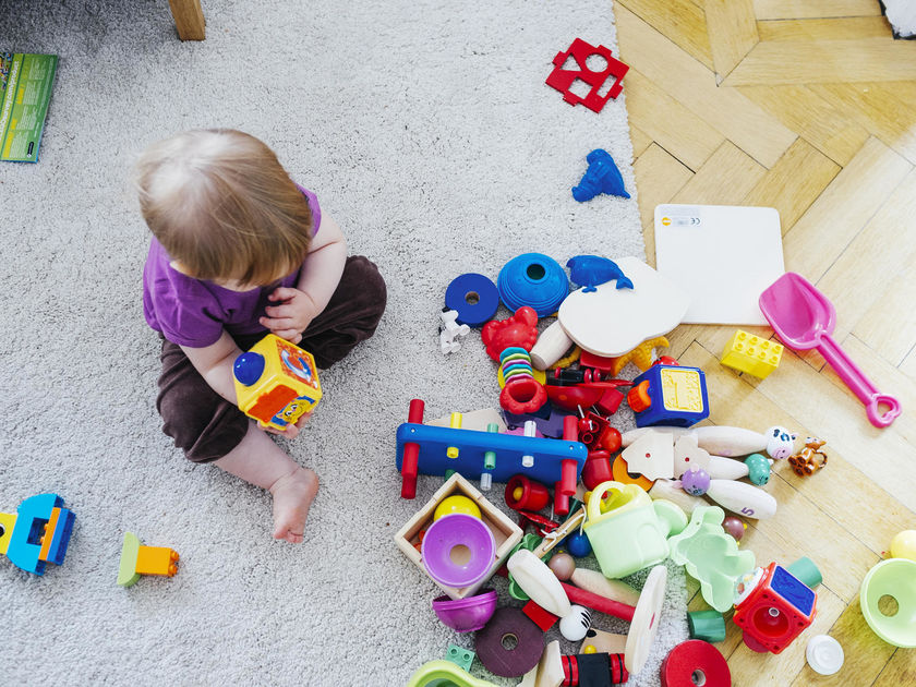 baby girl with toys scattered
