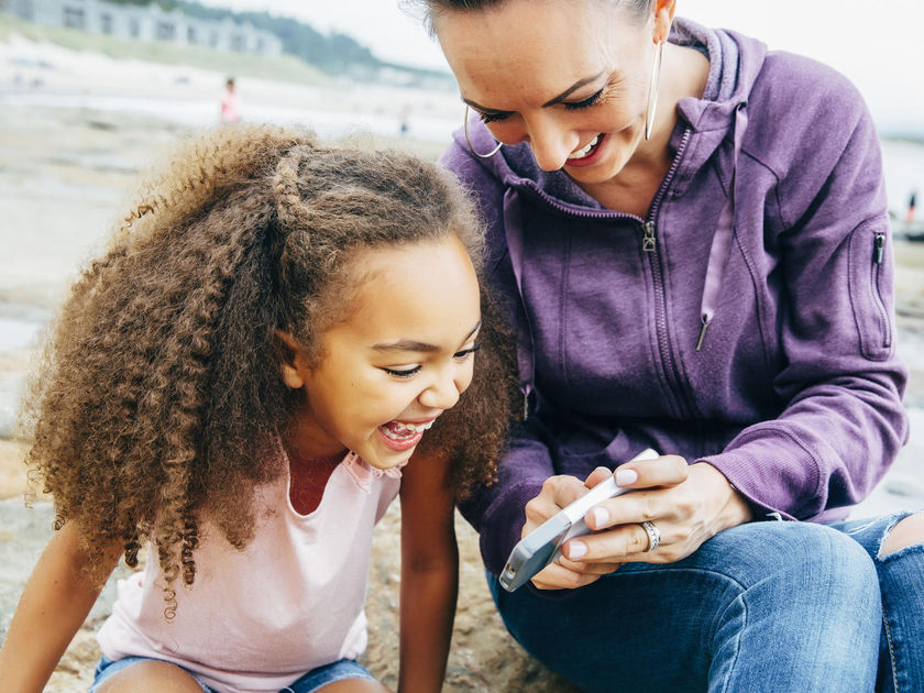 Little Girl and Mom Looking at Phone Joke