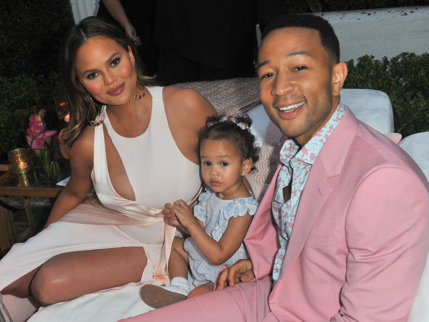 John Legend and Chrissy Teigen with Luna at LVE Rose Launch